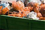 Dumpster full of garbage bags