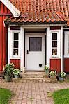 Doorway of Red Wooden House