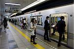 Passengers boarding Tokyo's Hibiya subway line, Tokyo, Japan, Asia