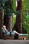Woman Relaxing on Deck, Santa Cruz County, California, USA