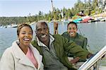 Three generation family on fishing trip, smiling, (portrait)