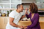 Woman feeding cake to boyfriend