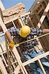 Travailleur de la construction bâtiment de mesure