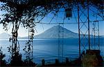 The view across Lake Atitlan from a pergola in the gardens of Hotel Atitlan,towards San Pedro Volcano.