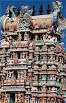 Exuberant and colourful sculpture decorates the main gopura or gateway of the enormous Shri Meenakshi-Sundareshwarar temple
