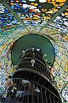 Japan,Honshu Island,Kanagawa Prefecture,Fuji Hakone National Park,Chokokunomori Sculpture Park. Kaleidoscopic stained glass windows and spiral staircase of viewing platform.