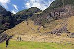 Tristan Da Cunha Island, settlement capital of Edinburgh. Walkers exploring the foothills of the Queen Mary Volcano