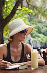 Woman at beachside restaurant on Hat Rai Leh West beach, Railay, Krabi Province, Thailan.
