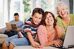 Multi-generation family enjoying computer