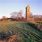 Friesland, church tower on a terp (artificial hill) at Firdgum village.