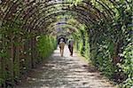 Couple walking in Mirabell Gardens