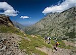 Hikers descending Monte Cinto