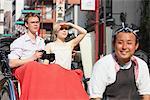 Young Couple Sitting In Rickshaw In Asakusa, Japan