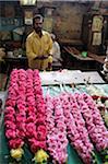 India, Tamil Nadu, Madurai. Flower garland maker at the Minakshi Sundareshvara Temple.