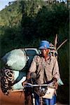 Mozambique, near Nampula. a man poses with his heavy cargo of coal.