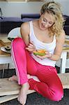 Happy woman eating a papaya