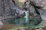 Stream dropping into pool Njesuthi Valley, Drakensberg Mountains, KwaZulu-Natal Province, South Africa