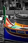 Malta, St. Julians Bay, St. Julians, colourful fishing boat.