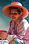 Thailand. An old lady at the bustling floating market at Damnern Saduak, 80 km southwest of Bangkok.