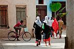 Tanzania, Zanzibar, Stone Town. A typical scene in one of Stone Town s maze of narrow streets.