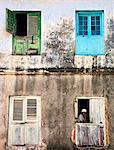 Tanzania, Zanzibar, Stone Town. The shuttered windows of an old building in Stone Town.