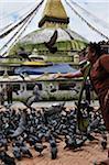 Woman Feeding Pigeons, Boudhanath, Bagmati Zone, Madhyamanchal, Nepal
