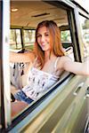 Teenage Girl Sitting in Car