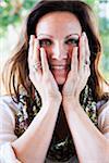 Woman Touching Cheeks