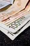 A pile of Euro bills, close-up.