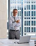 Businessman standing near desk in office