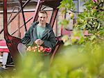 Farmer holds basket of apples
