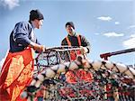 Fishermen loading boat with lobster pots