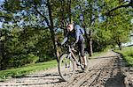 Man cycling down a dirt road
