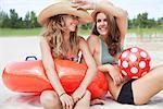 Women sitting on a beach relaxing