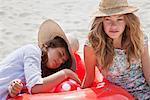 Pretty women relaxing on the beach