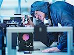 Scientist inspecting laser crystal