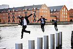 Three businesspeople jumping