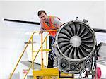 Engineer inspecting jet engine
