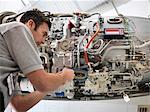 Engineer works on jet engine