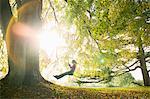 Girl on swing in sun