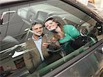 Customers look at car interior