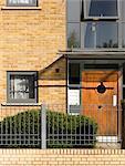 Stonebridge Housing Action Trust Estate. Wooden front door. Architects: Sprunt