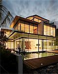 Modern glass house at dusk. Architects: Lim Cheng Kooi and AR43
