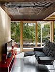Sofa and flat screen television. Architects: Studio BAAD