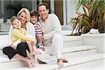 Portrait of Family Sitting on Steps