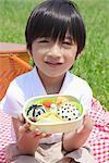 Japanese Boy Holding Lunch Box