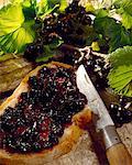 Blackcurrant jam spread on bread