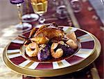 Quail with Dublin Bay prawns and  Vitelotte mashed potato quenelles