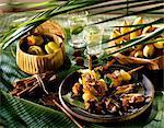 Pork and exotic fruit skewers