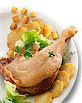 Jambe de confit de canard aux pommes de terre sautées